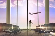 Thinking businesswoman against airplane flying past departures lounge