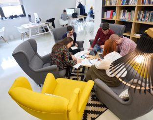 group of young business people , Startup entrepreneurs working on their venture in coworking space