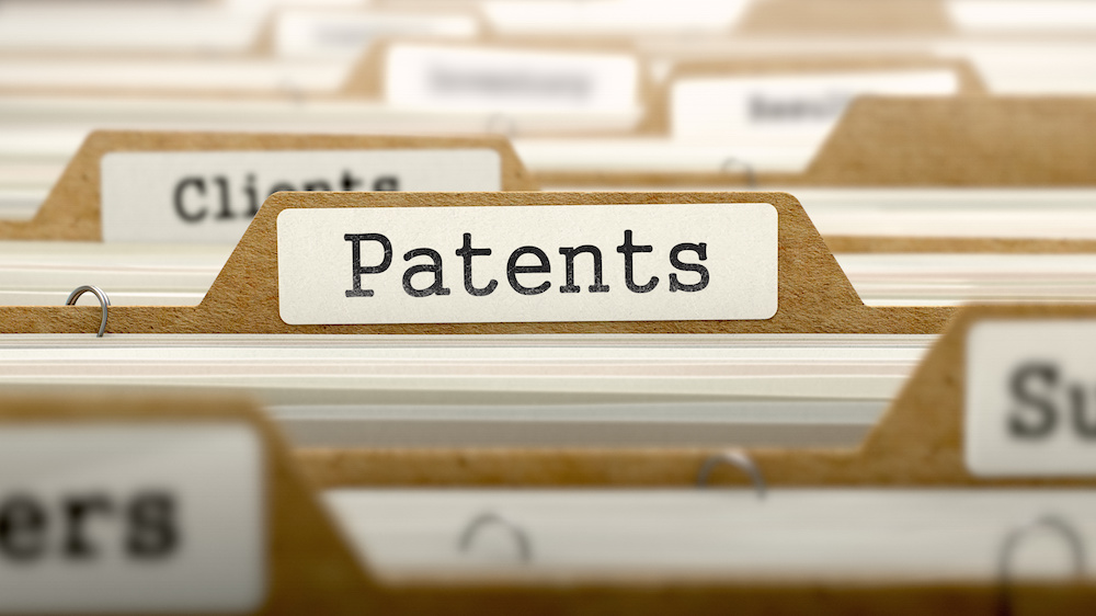 Patents Concept. Word on Folder Register of Card Index. Selective Focus.